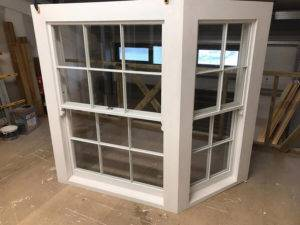 white bay window on workshop floor