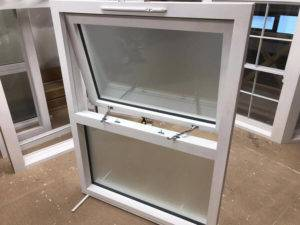 window frame with frosted window on showroom floor