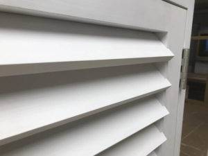 close up of white window shutter